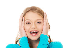 Excited молодая женщина держа ее голову Стоковая Фотография RF