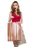 Excited молодая женщина с хозяйственными сумками Стоковая Фотография RF