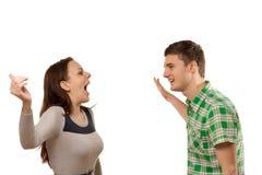 Excited молодой человек и женщина Стоковые Фото