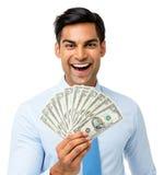 Excited примечания доллара бизнесмена дуют удерживанием, который вне Стоковое Изображение