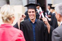 Excited студент-выпускник мужчины стоковая фотография rf