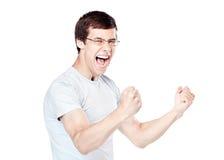 Excited человек празднуя выигрыш стоковые фотографии rf
