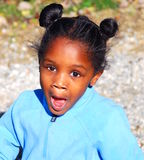 Excited. A young black girl is so excited while she plays outside Royalty Free Stock Image