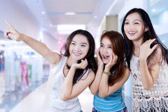 Excited adolescent girls at mall Stock Image