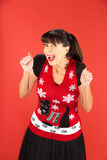 Excited adult female in ugly Christmas sweater Stock Photo