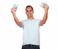 Excited adult man with cash money. Portrait of an excited adult man with cash money against white background Stock Photo