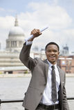 Excited African American businessman with St. Paul's Cathedral in the background Stock Image