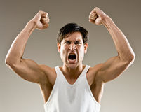 Excited and aggressive athlete cheering Stock Image