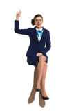 Excited Air Stewardess Sitting And Pointing Up Stock Image