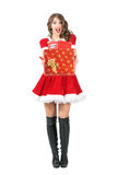 Excited amazed mrs. Santa Claus giving many gifts looking at camera. Royalty Free Stock Photo