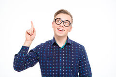 Excited amusing young male pointing up and having an idea Royalty Free Stock Photo