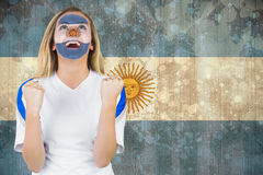 Excited argentina fan in face paint cheering Royalty Free Stock Photography