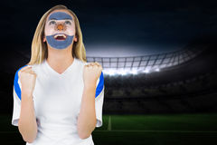 Excited argentina fan in face paint cheering Royalty Free Stock Photo