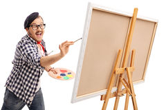 Excited artist painting on a canvas Royalty Free Stock Image