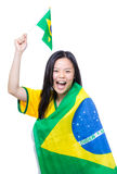 Excited asia female football supporter holding small Brazil flag Royalty Free Stock Image
