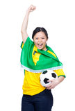 Excited asia female football supporter holding soccer ball Royalty Free Stock Photos