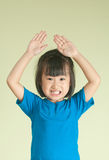 Excited asia little child raising two hand up Royalty Free Stock Images