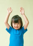 Excited asia little child raising two hand up Stock Photos