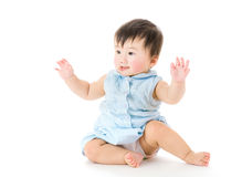 Excited asian baby girl hand up Royalty Free Stock Photography