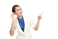 Excited Asian business woman point to blank space Stock Image