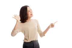 Excited Asian business woman point to blank space Royalty Free Stock Photo
