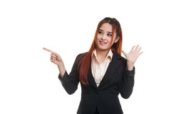 Excited Asian business woman point to blank space. Royalty Free Stock Images