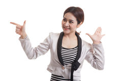 Excited Asian business woman point to blank space. Stock Photography