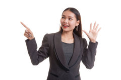 Excited Asian business woman point to blank space. Royalty Free Stock Photo