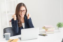 Successful female wear glasses with victory gesture royalty free stock photo