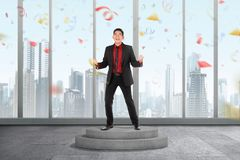 Excited asian businessman celebrate his successful. On the office stock photo