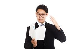Excited Asian businessman read a book Stock Photo