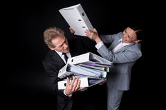 Excited asian businesswoman with folder fighting with scared businessman holding folders Stock Images