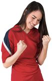 Excited asian football fan cheering Stock Photos