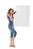 Excited Asian girl hold a blank board Royalty Free Stock Photos