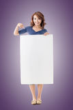 Excited Asian girl hold a blank board Stock Photo
