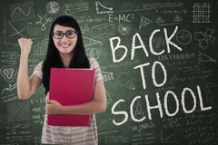 Excited asian student in class Royalty Free Stock Images