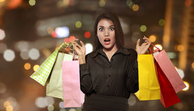 Excited asian woman holding colorful paper bag celebrating Black. Friday on the mall Stock Photography
