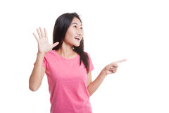 Excited Asian woman point to blank space.. Royalty Free Stock Photos