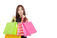 Excited Asian woman point to empty space with shopping bags Stock Image