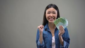 Excited Asian woman showing euro banknotes on camera, lottery winner, fortune. Stock footage stock footage