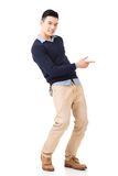Excited Asian young man Royalty Free Stock Photos