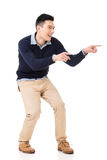 Excited Asian young man Stock Image