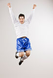 Excited athlete cheering. Excited athlete in sportswear cheering and celebrating his success Stock Image