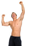 Excited athlete raises his arms for victory Stock Photos