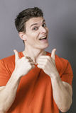 Excited athletic man with thumbs up for sporty dynamism Stock Images