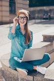 Excited attractive girl is doing her university project on a lap Stock Photography