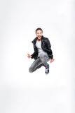 Excited attractive young man screaming and jumping Stock Images