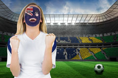 Excited australia fan in face paint cheering Stock Photo