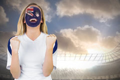 Excited australia fan in face paint cheering Stock Images