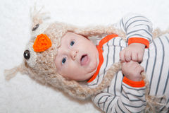 Excited Baby in Owl Hat Stock Photo